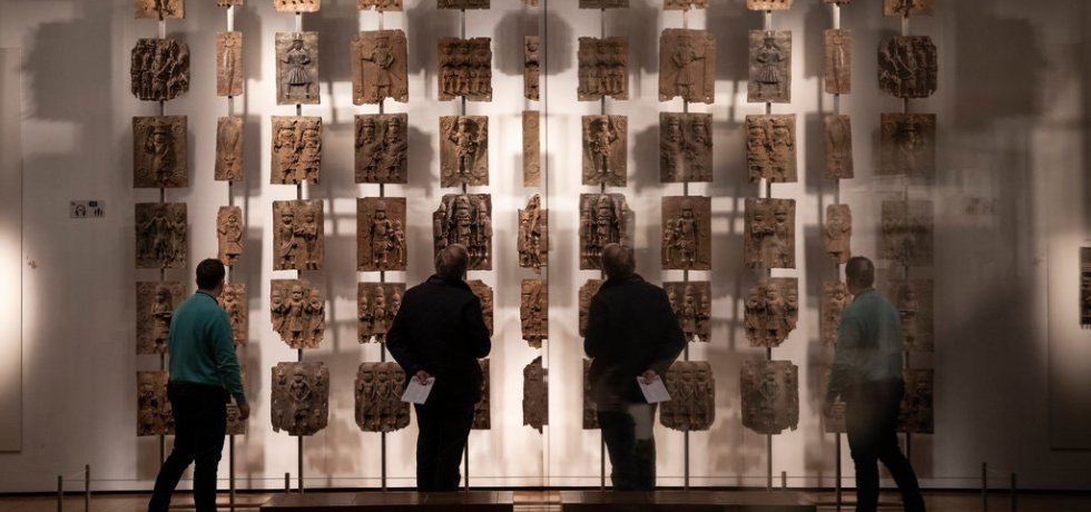 Plaques that form part of the Benin Bronzes on show at the British Museum in London. The plaques were taken by British troops in 1897.Credit...Dan Kitwood/Getty Images